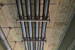 Pipes under bridge Stock Image