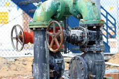 Pipes and Valves 1. Pipes and turn valves at an industrial construction site Stock Image