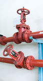 Pipes with valves. Red pipes with two valves Royalty Free Stock Image