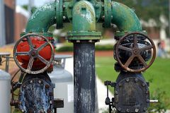 Pipes and Valves 2. Some pold pressure pipes and their circular valve handles Royalty Free Stock Images