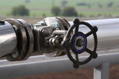 Pipes and valves. In industrial petrochemical plant Royalty Free Stock Photography