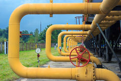 Pipes with valves on gas compressor station. Pipes with valves and manometers on cooling gas compressor station installation Stock Photos