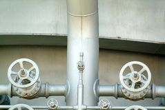 Pipes and valves in industrial petrochemical factory Stock Image