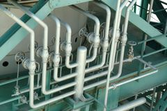 Pipes and valves in industrial petrochemical factory royalty free stock image