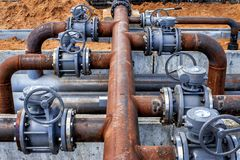 Pipes and valves at the oil refinery Stock Image