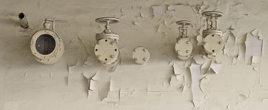 Pipes and valves and paint flakes Stock Images