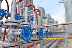 Pipes and valves in petrochemical factory stock images