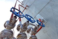 Pipes and valves in petrochemical industry. Pipes and valves in industrial petrochemical plant Stock Photo