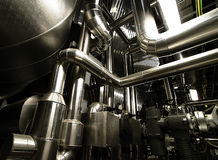 Pipes and valves at a power plant Stock Photo