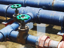 Pipes and Valves. Two Pipes and Blue Valves Stock Image
