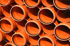 Pipes warehouse abstract. Colorful PVC pipes abstract. Industrial object concept royalty free stock image