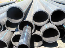 Pipes for water supply. Water pipes from rubber liing pile Stock Photos