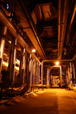 Pipess inside energy plant. Different types of pipes and tanks inside energy plant Royalty Free Stock Photography