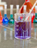 Pipette in the beaker Royalty Free Stock Images