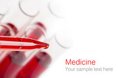 Pipette with drop of blood Stock Photography