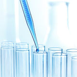 Pipette with drop of liquid Royalty Free Stock Images
