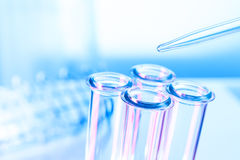 Pipette and test tube on blue background Stock Photo