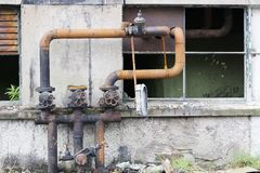 Pipework arrangement with valves left rusty and dirty stock images