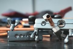 Pipework concept. Pipe rammer tool on a fitter workbench. Pipework concept background stock photo