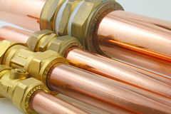 Pipework. Made up copper pipes with various compression fittings attached stock photos