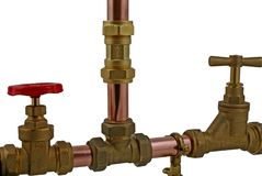 Pipework. A side view of copper pipework and fittings on a white background stock photo