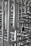 Piping. Interlacement of stainless polished pipes Stock Images