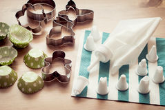 Piping bag set with cookie cutters and cups for cupcakes Stock Image