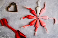 Piping bags. With colors range from white to red, with different gradation over a gray background stock photography