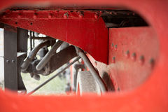Piping detail and structure under the walkway of a steam locomotive FS 940 restored, with intentionally blurred foregraund. Royalty Free Stock Photography