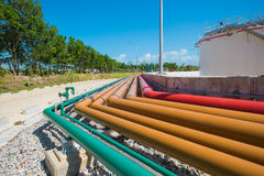 Piping of many systems in fuel oil storage area Royalty Free Stock Images