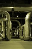 Piping at a power plan. An assortment of different size and shaped pipes at a power plant Royalty Free Stock Photo