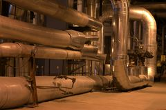 Piping at a power plan. An assortment of different size and shaped pipes at a power plant Stock Images