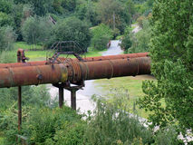 Piping system in the Open. Old pipe in a green park Royalty Free Stock Photo
