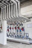 Piping systems, industrial equipment, interior - Gas station pipe equipment.  Royalty Free Stock Photo