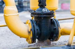 Piping systems with pressure regulating valve, industrial equipment, interior.  Stock Photo