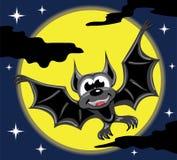 Pipistrello davanti alla luna ed al cielo notturno gialli Fotografia Stock