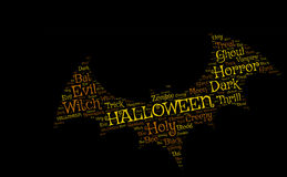 Pipistrello di Hallowen su un fondo nero: parole gialle ed arancio Fotografie Stock Libere da Diritti