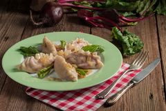 Piquant pierogi with Beetroot and cheese filling Stock Photos
