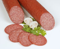 Piquant Salami. Tasty salami on white background royalty free stock images