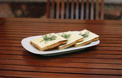 Piquant sandwich with cheese and fennel on the pla Stock Photo
