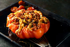 Piquant stuffed roasted ripe red tomato Stock Photos