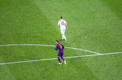 Pique of FC Barcelona and Ibrahimovic of PSG in action. In champions league game on 10 December 2014 Stock Image