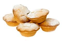Pique las empanadas con la polvoreda del azúcar de formación de hielo Imagenes de archivo
