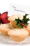 Pique las empanadas para Santa Imágenes de archivo libres de regalías