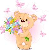 Pique o urso da peluche com flores Imagens de Stock Royalty Free