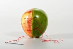 Piquer malpropre sur des pommes Image stock