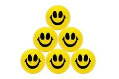 Pirámide de bolas amarillas sonrientes Imagen de archivo