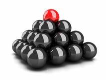 Pirámide de esferas negras y del arranque de cinta rojo superior de la esfera Imagen de archivo