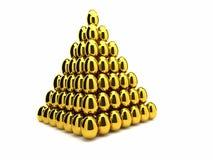 Pirámide de oro del huevo Foto de archivo