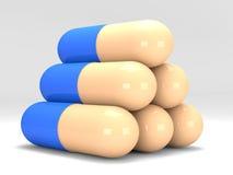 Pirámide de píldoras en el fondo blanco Fotografía de archivo